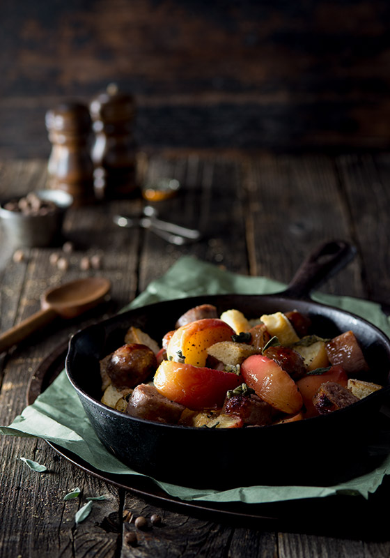 Apple and Sausage Roast Pan with Allspice and Sage Food Stock Photo