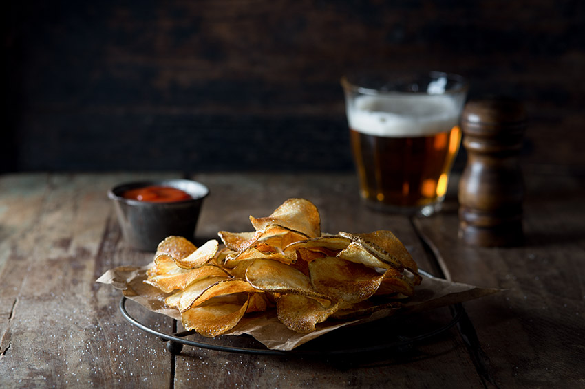 Potato Chips with Ketchup and Beer Stock Food Photo