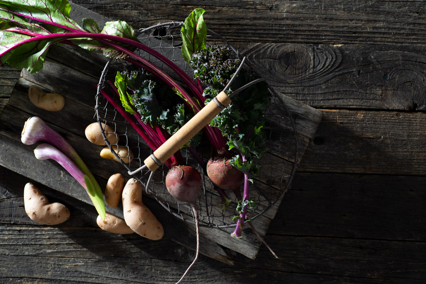 Fresh Raw Vegetables on a Rustic Farmhouse Table Stock Food Photo