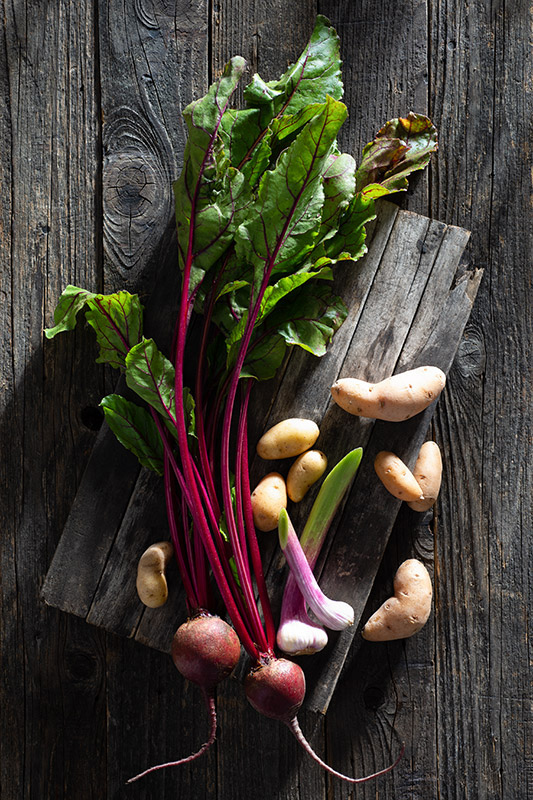Raw Vegetables on a Rustic Farmhouse Table Stock Food Photo
