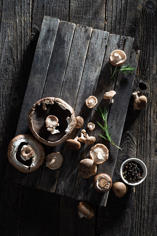 Raw Mushrooms with Fresh Herbs on a Rustic Farmhouse Table Stock Food Photo