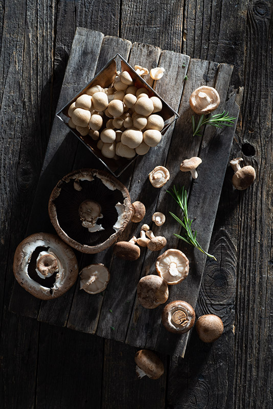 Raw Mushrooms on a Rustic Farmhouse Table Stock Food Photo