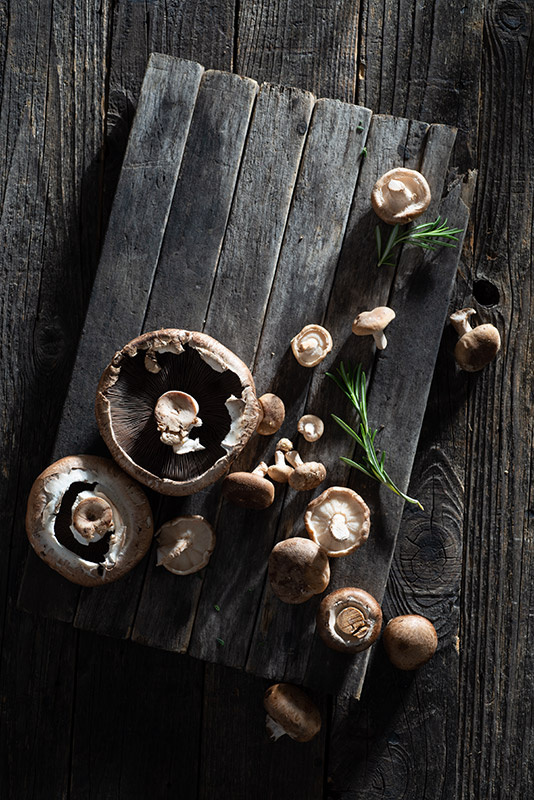 Mushrooms on a Rustic Farmhouse Table Stock Food Photo
