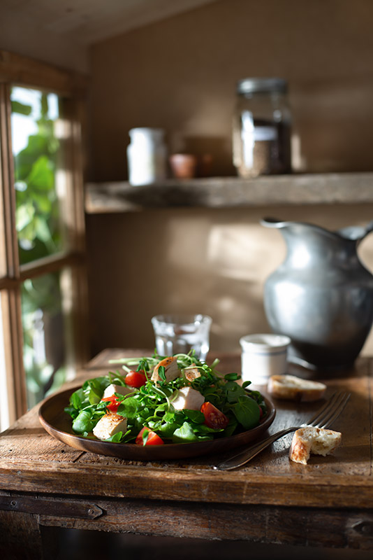 Salad with Grilled Chicken in a Rustic Farmhouse Kitchen Stock Food Photo