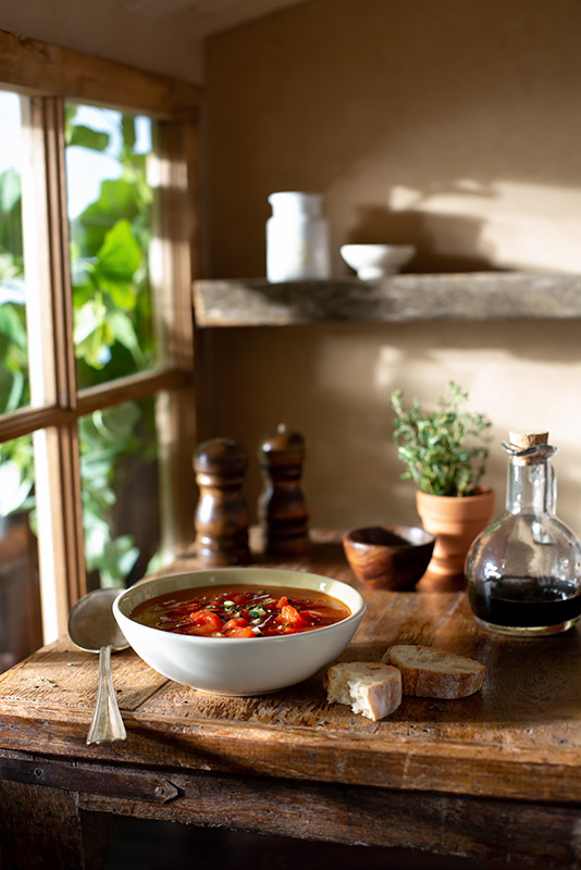 Tomato Gazpacho Cold Summer Soup in a Rustic Farmhouse Kitchen Stock Food Photo