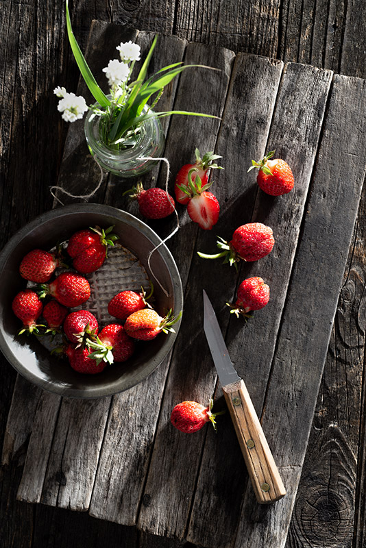 Freshly Harvested Homegrown Summer Strawberries on a Rustic Farmhouse Table Stock Food Photo