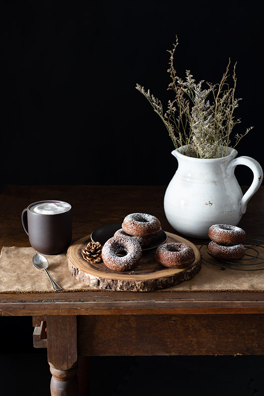 Chocolate Donuts on a Rustic Farmhouse Table Stock Food Photo