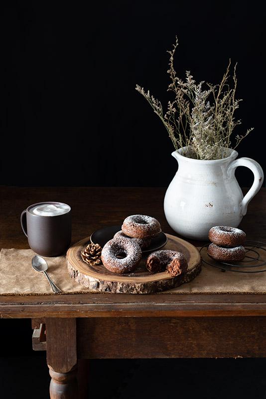 Chocolate Donuts on a Farmhouse Table Stock Food Photo