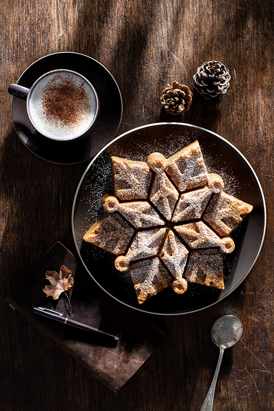 Snowflake Cake with Cappuccino in the Late Afternoon Autumn Sun Stock Food Photo