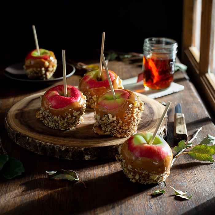 Caramel Apples on a Farmhouse Table Stock Food Photo