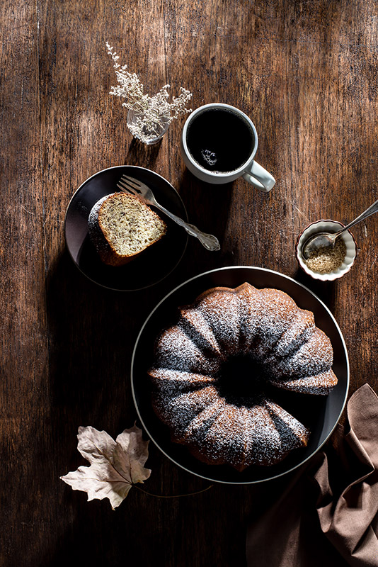 Bundt Cake with Coffee in the Late Afternoon Autumn Sun Stock Food Photo