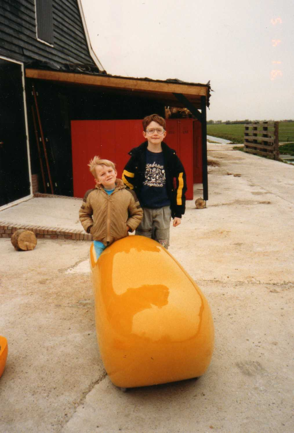My brother and I in Holland, in a big ass clog, keeping out feet protected from bad...things.