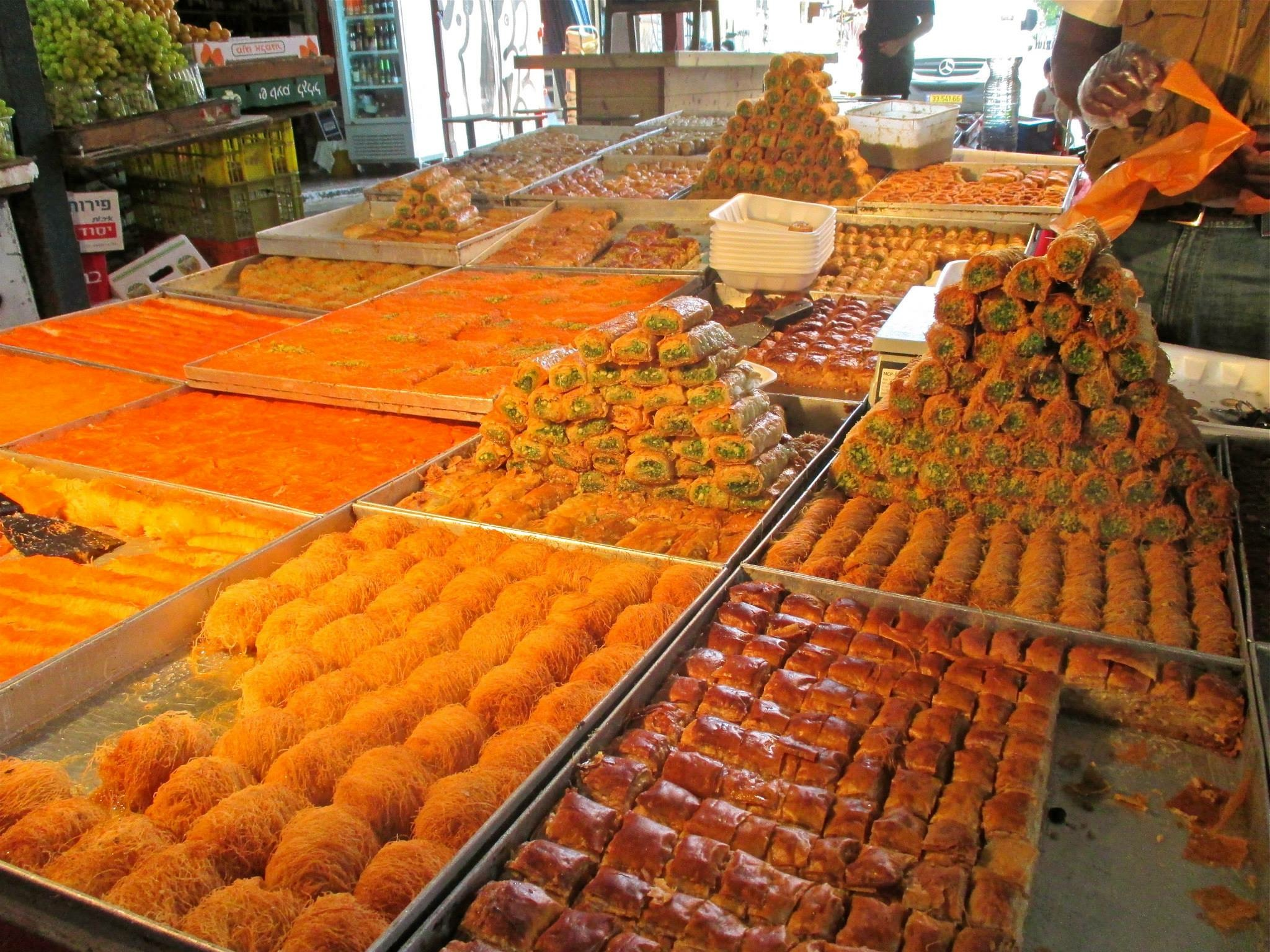 Pastries, including walnut and pistachio baklava, from a typical market