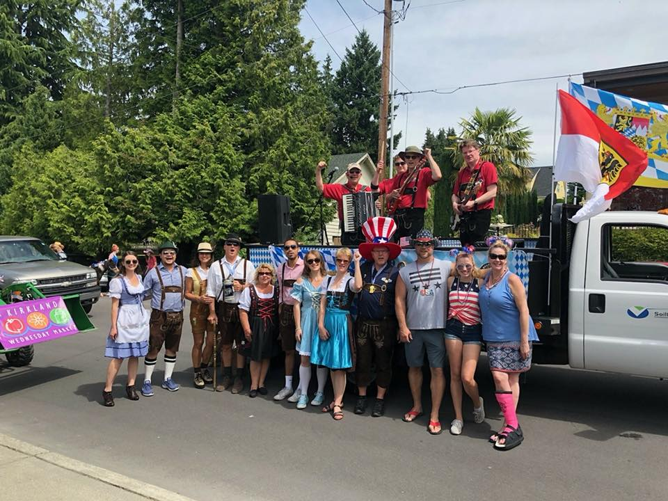 The Oktoberfest Team, Bavarian Beer Garden Band, and Soilfreeze team ready for the Kirkland 4th of July Parade 2018