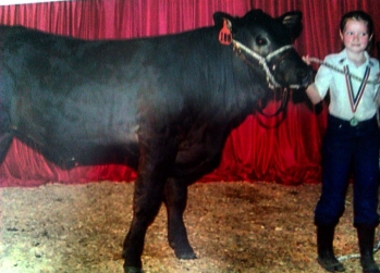 This was me at my first cow show. I was 8 years old, and yes the cow has back legs.