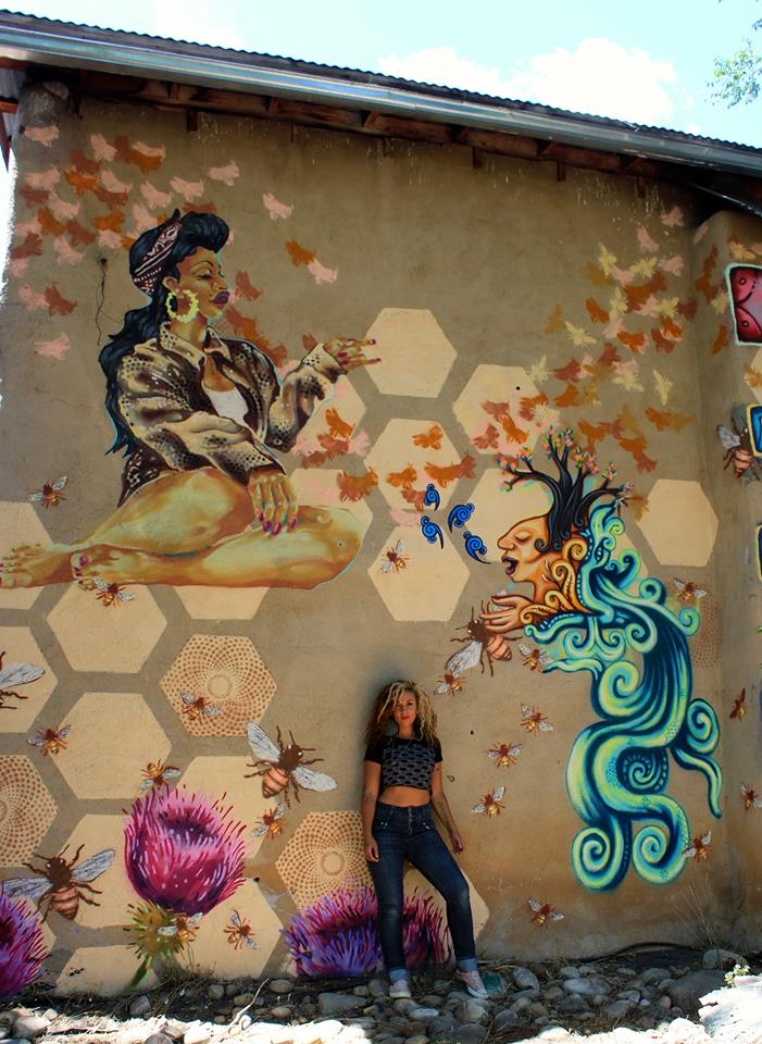 Artist Amaryllis DeJesus Moleski, mural collaboration with Artist Rebekah Tarin in Penasco, NM.