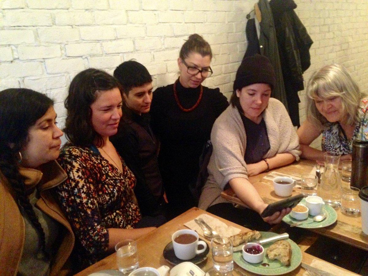 Tania Willard, Maria Hupfield, IV Castellanos, Ginger Dunnill, Tarah Hogue, Cherylle L'Hirondelle viewing Tanya Tagaq's Retribution video. Vancouver, BC.