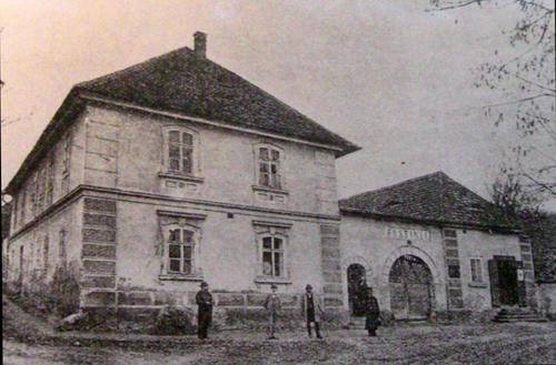 Oldest known photo (1888) of the house where Dvořák was born. Standing third from left: the composer.