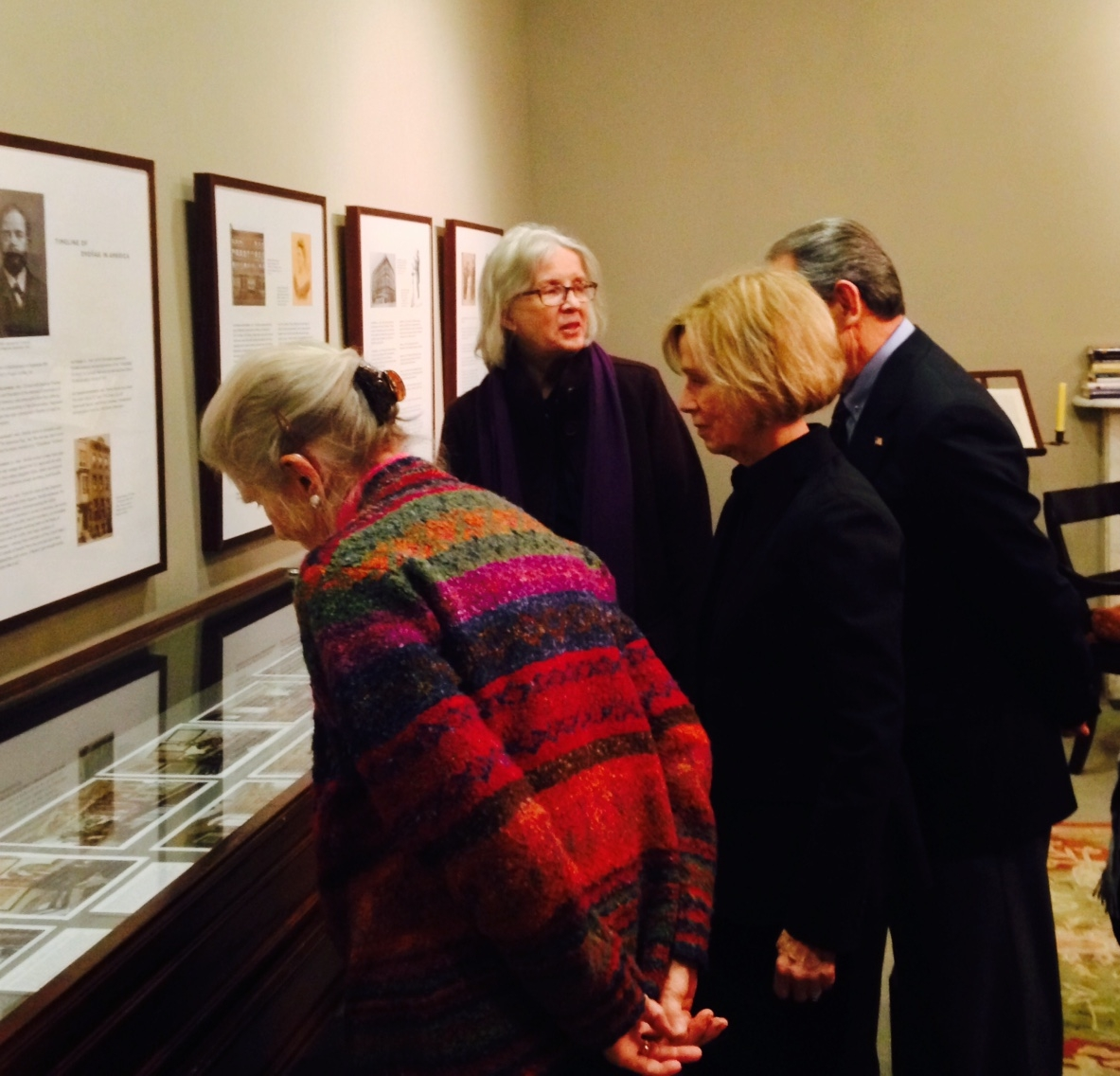 "Guests tour the ""Mythic Bohemia"" exhibit in the Dvořák Room with Majda Kallab Whitaker."