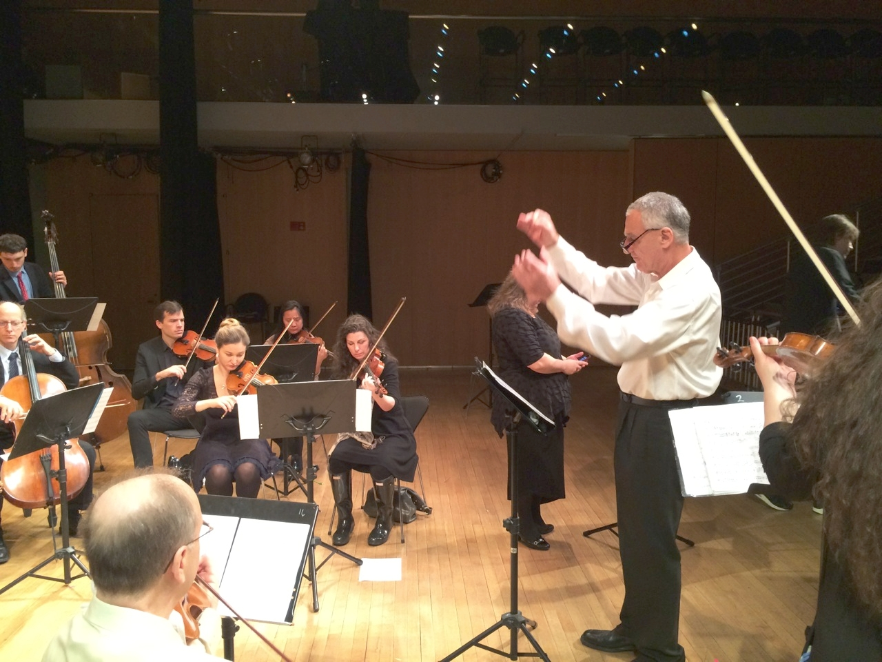 "Rehearsal of Moshe's Knoll's ""Psalm 133"" for soprano, violin, and string orchestra. Photo credit: Laura Goldberg."