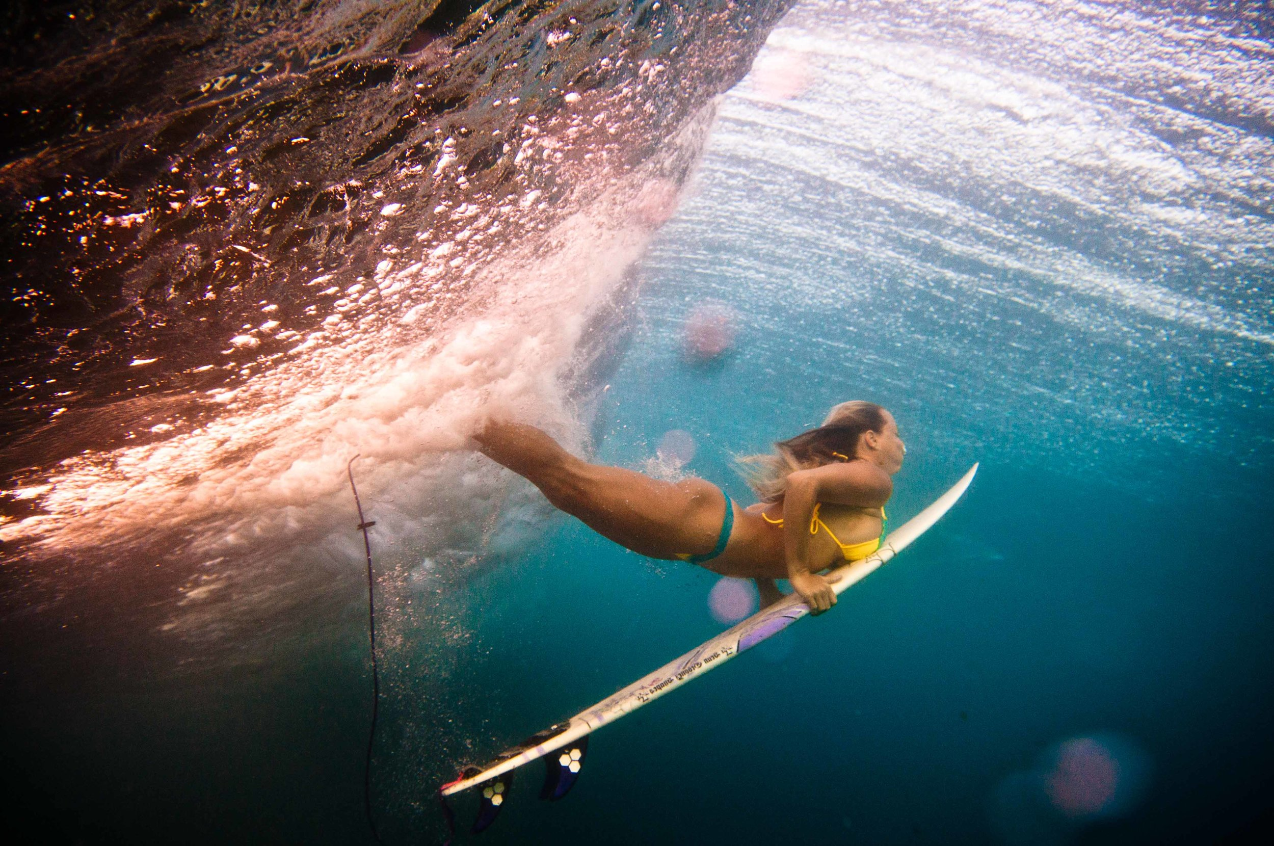 Duck diving, an undeniable advantage of shortboarding. Photo: thesurfphotog.com