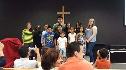 Pastor Aaron Sucaldito with the of the Academy students