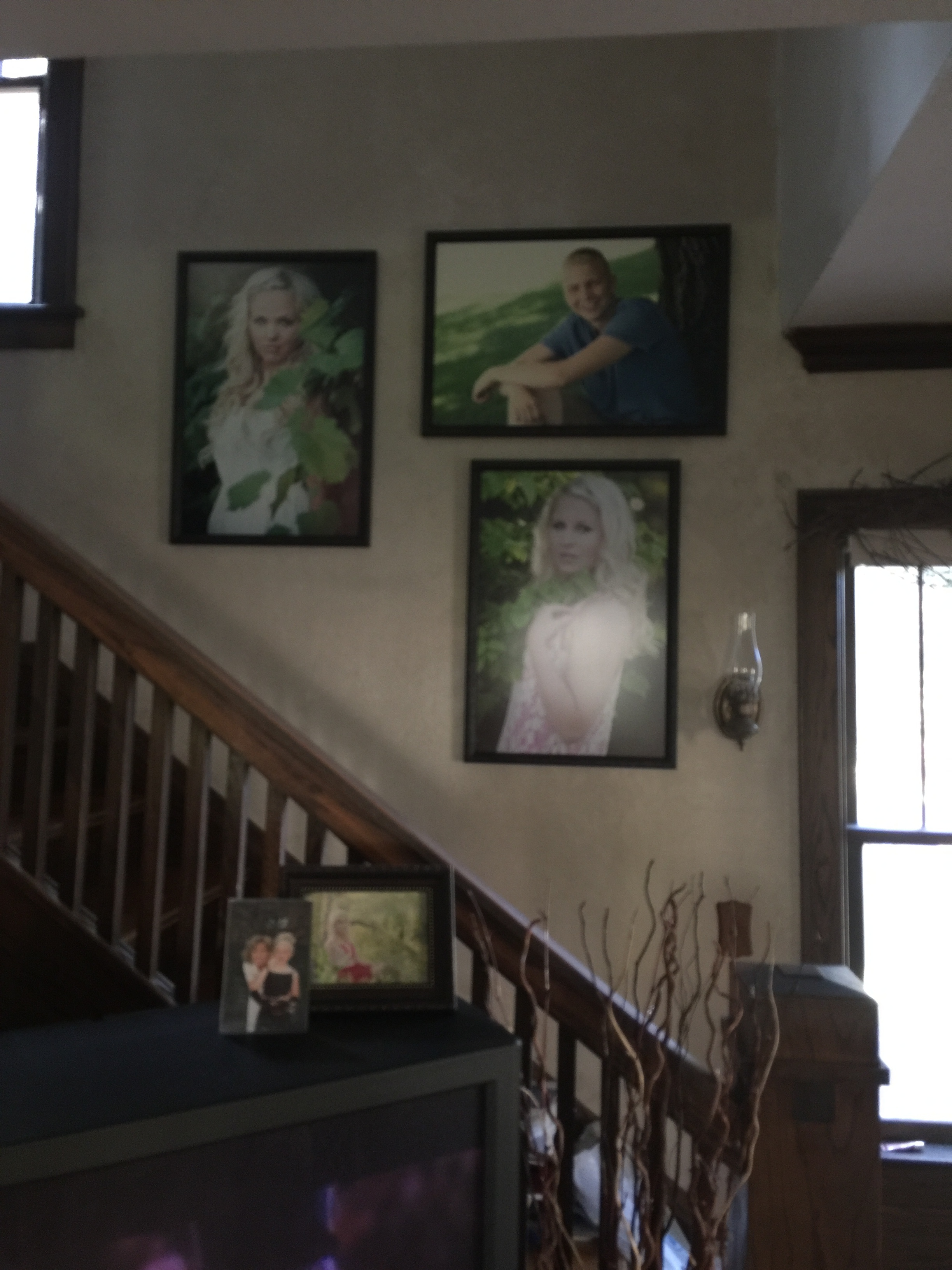 Carter's wall image hanging in his home next to his sisters's images!