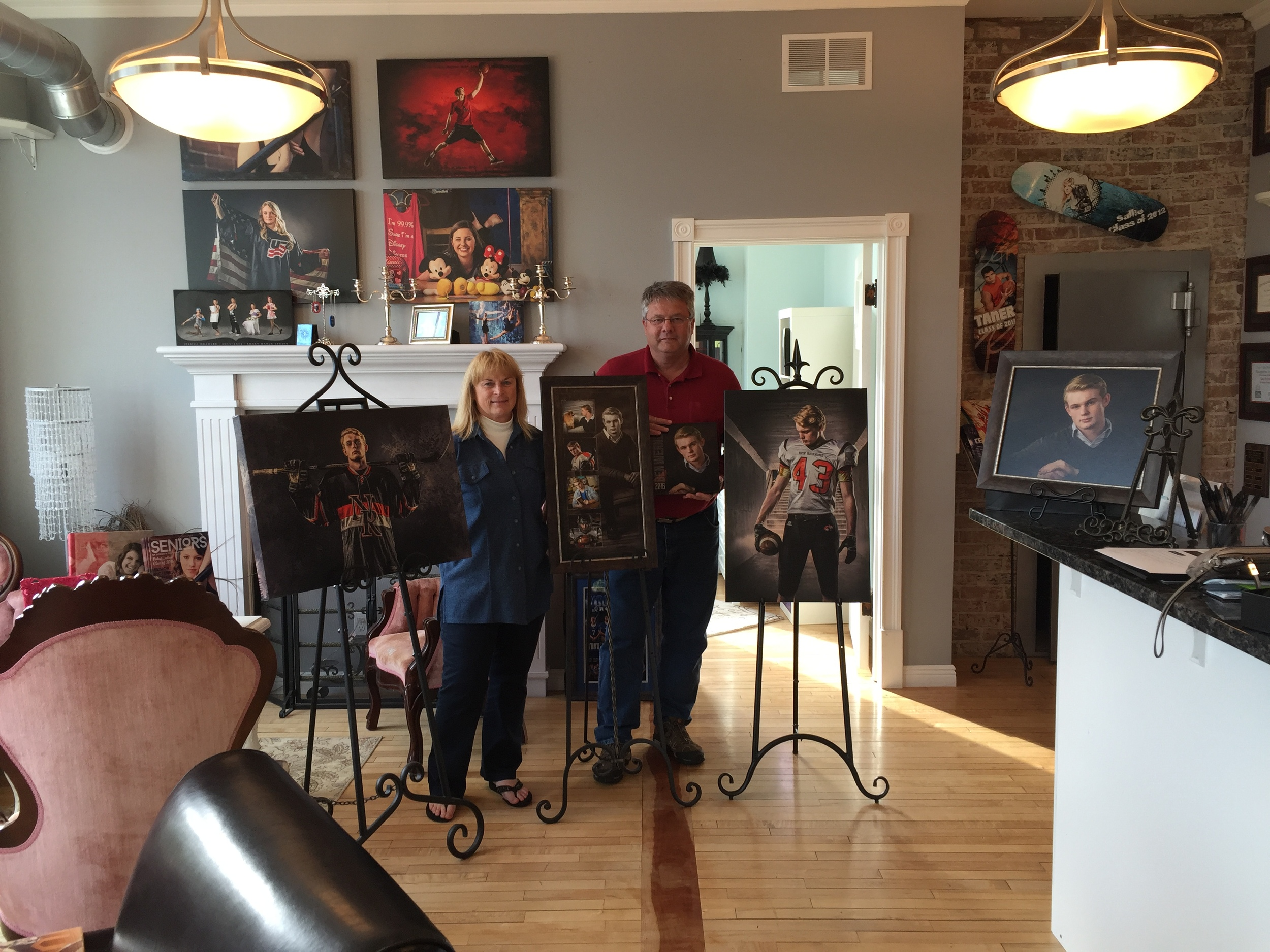 The Werner Family with their son, Ben's wall art collection and Senior album.