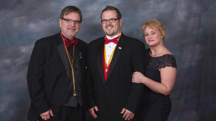 Nate Peterson (center) of NP Design and Photography is shown receiving the Master of Photography honor from the Professional Photographers of America. Peterson is pictured with his wife, Teresa, and PPA president Michael Timmons. Peterson received the award at the PPA national convention in Atlanta on Jan. 10-12.