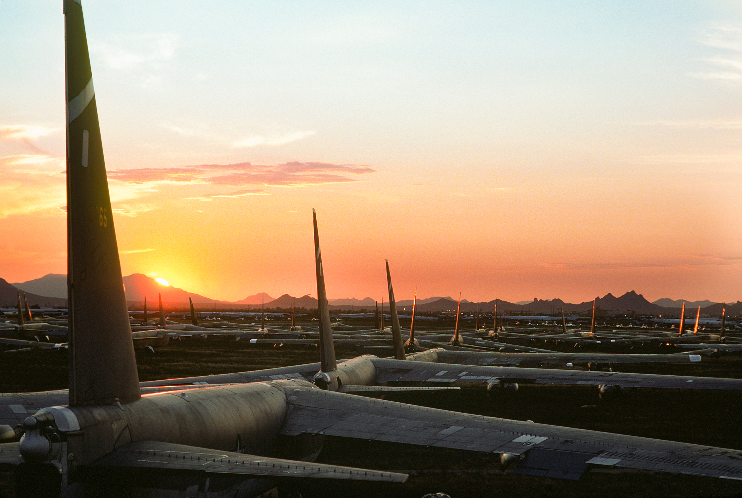 Dozens_of_B-52_Stratofortress_aircraft_are_bathed_in_the_glow_of_the_setting_sun_as_they_sit_on_the_desert_floor_at_the_Aerospace_Maintenance_and_Regeneration_Center_DF-ST-89-10582.jpg