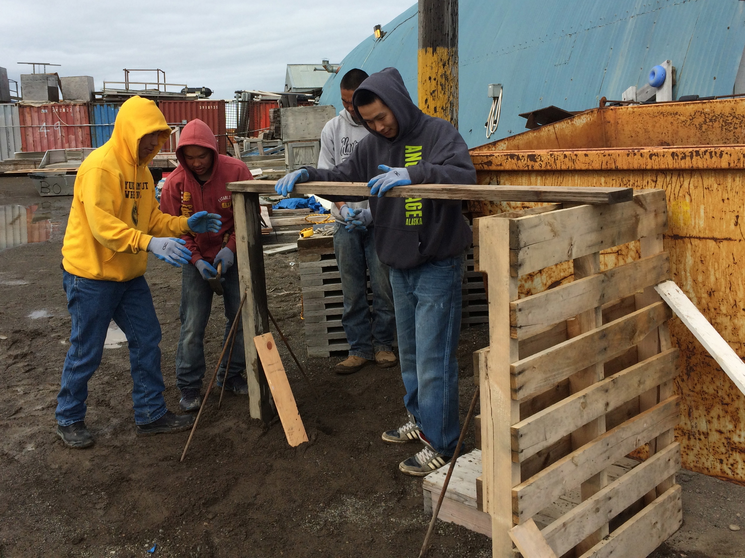 Ben, Geoffrey, Anu, and Mike P. work to stabilize their post and beam construction.