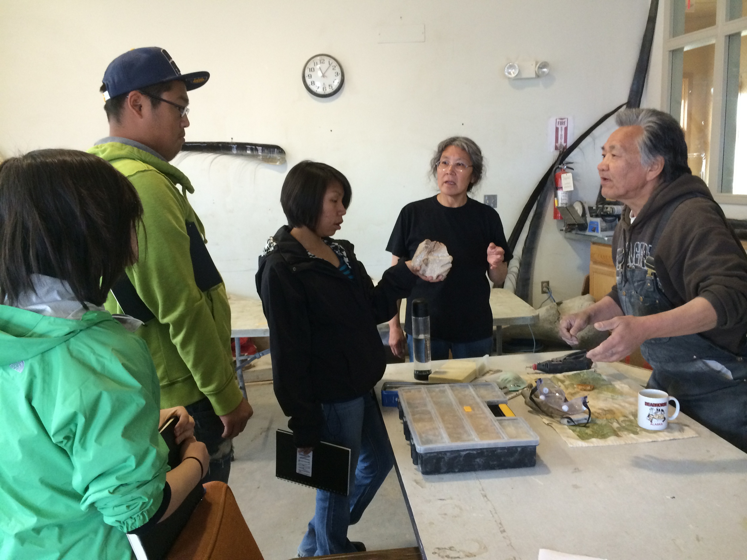 Kirsten, Mike O., and Marina talk with our guide and an artist about his craft.