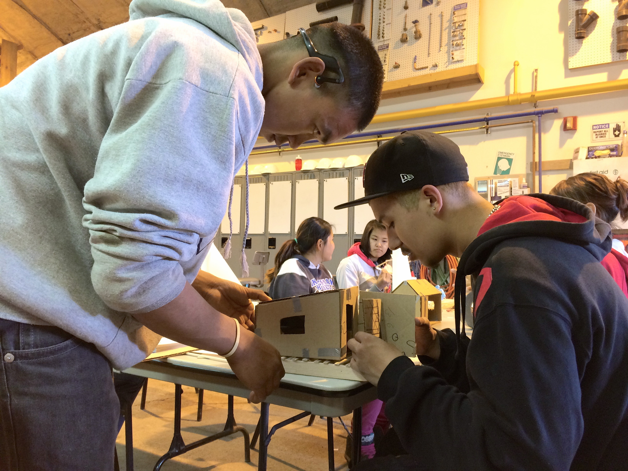 Anu and Branham work together to test the accuracy of their scale models.