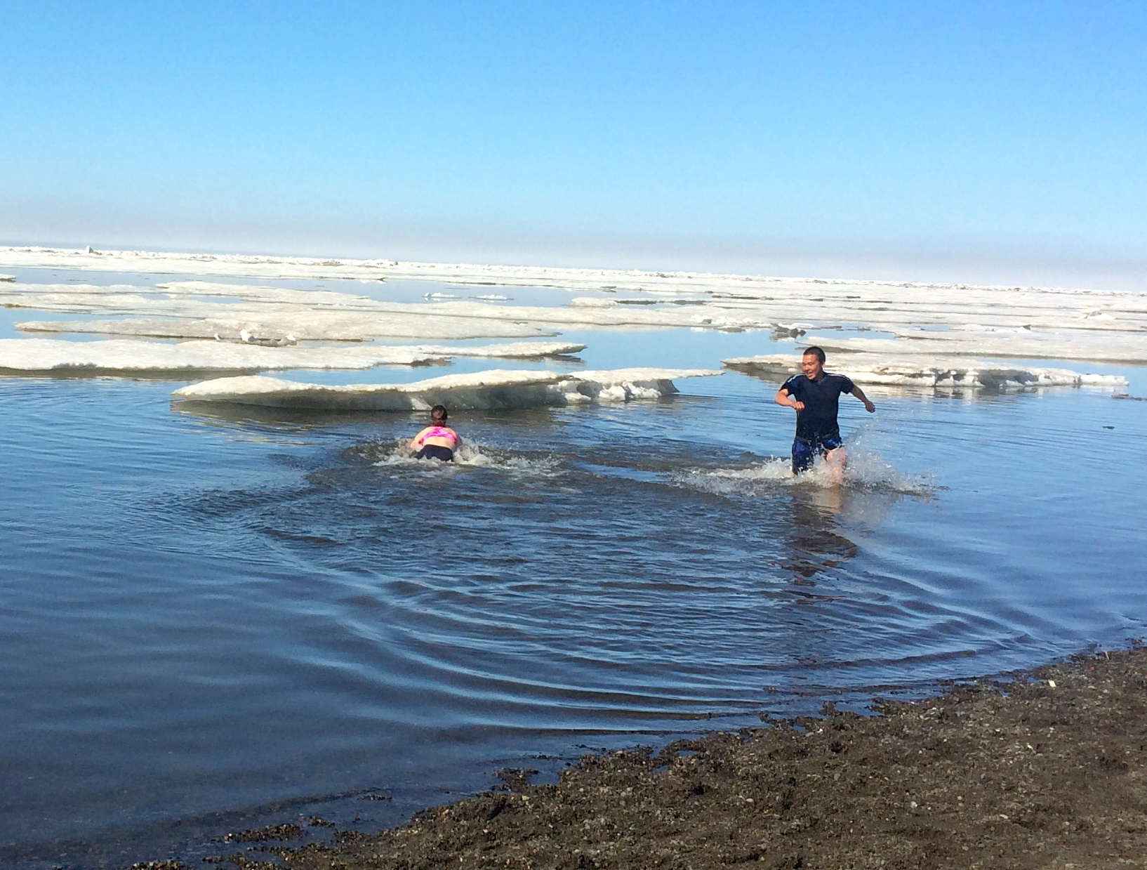 Geoffrey and I take our turn swimming out to touch the ice.