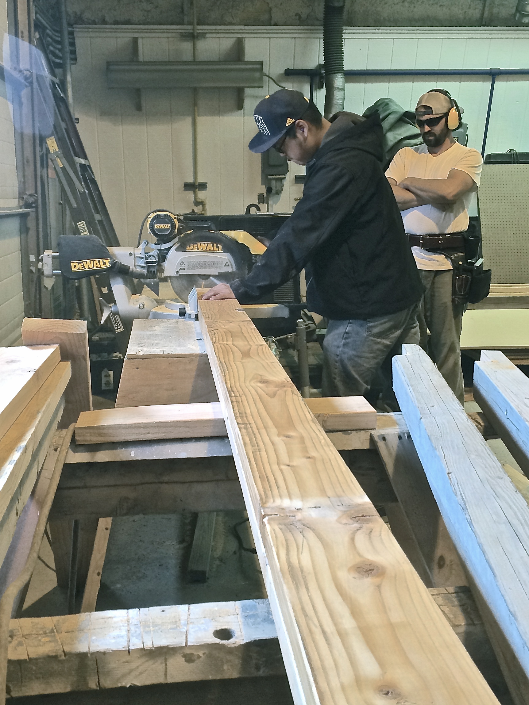 Mike O. takes a turn on the radial arm saw.
