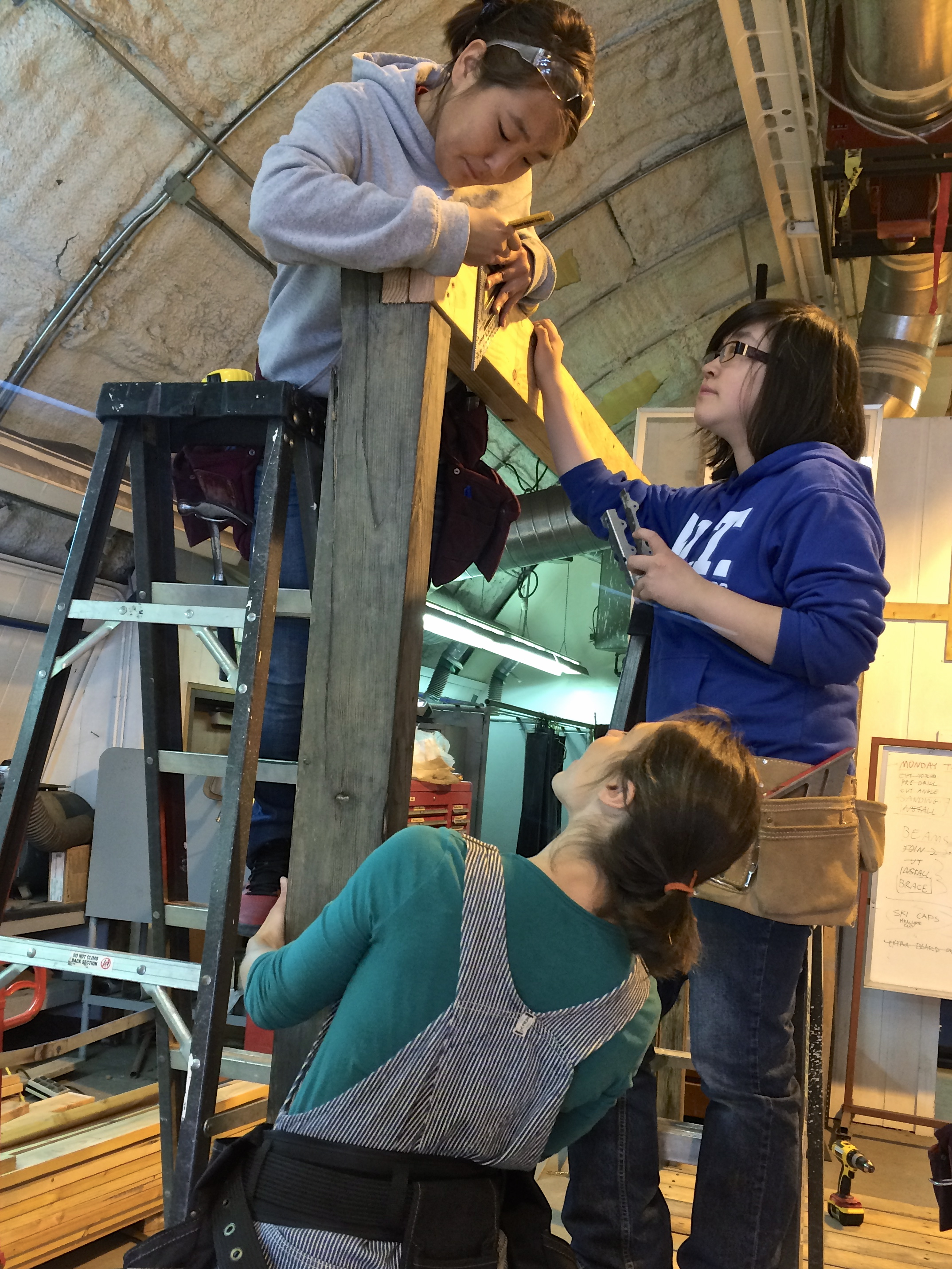 Misha and Kirsten get ready to install a joist hanger.