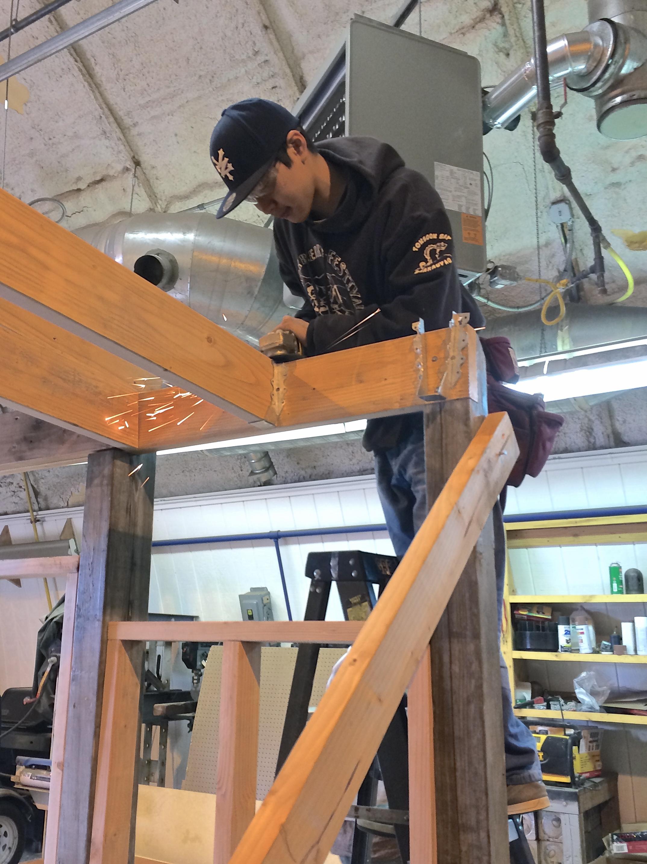 Mike P. grinds a joist hanger.