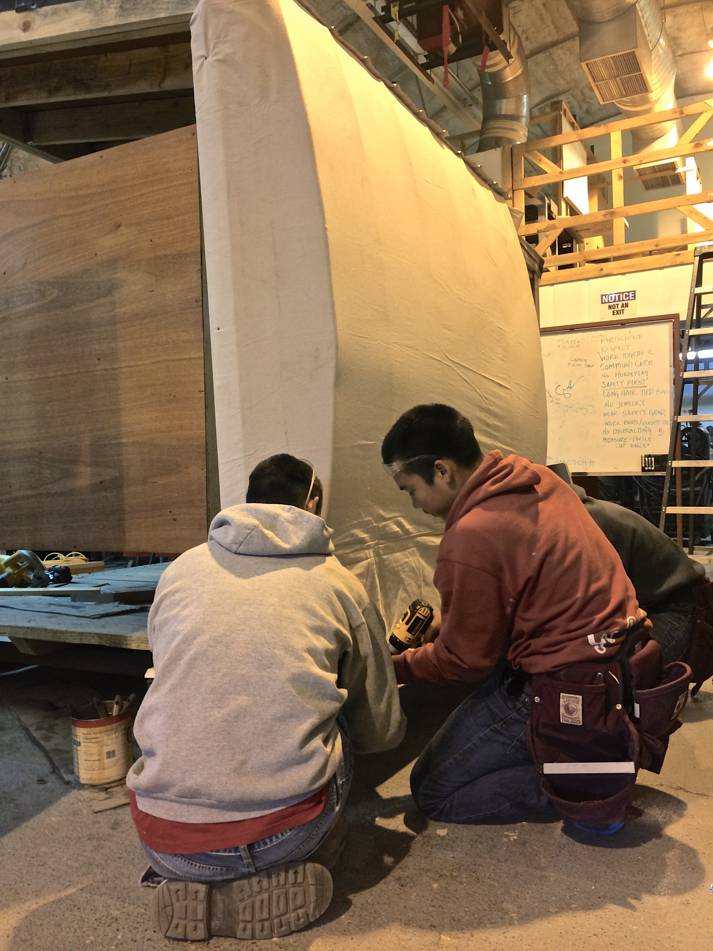 Stretching canvas over the ribs, like skins on an umiaq (skin boat).