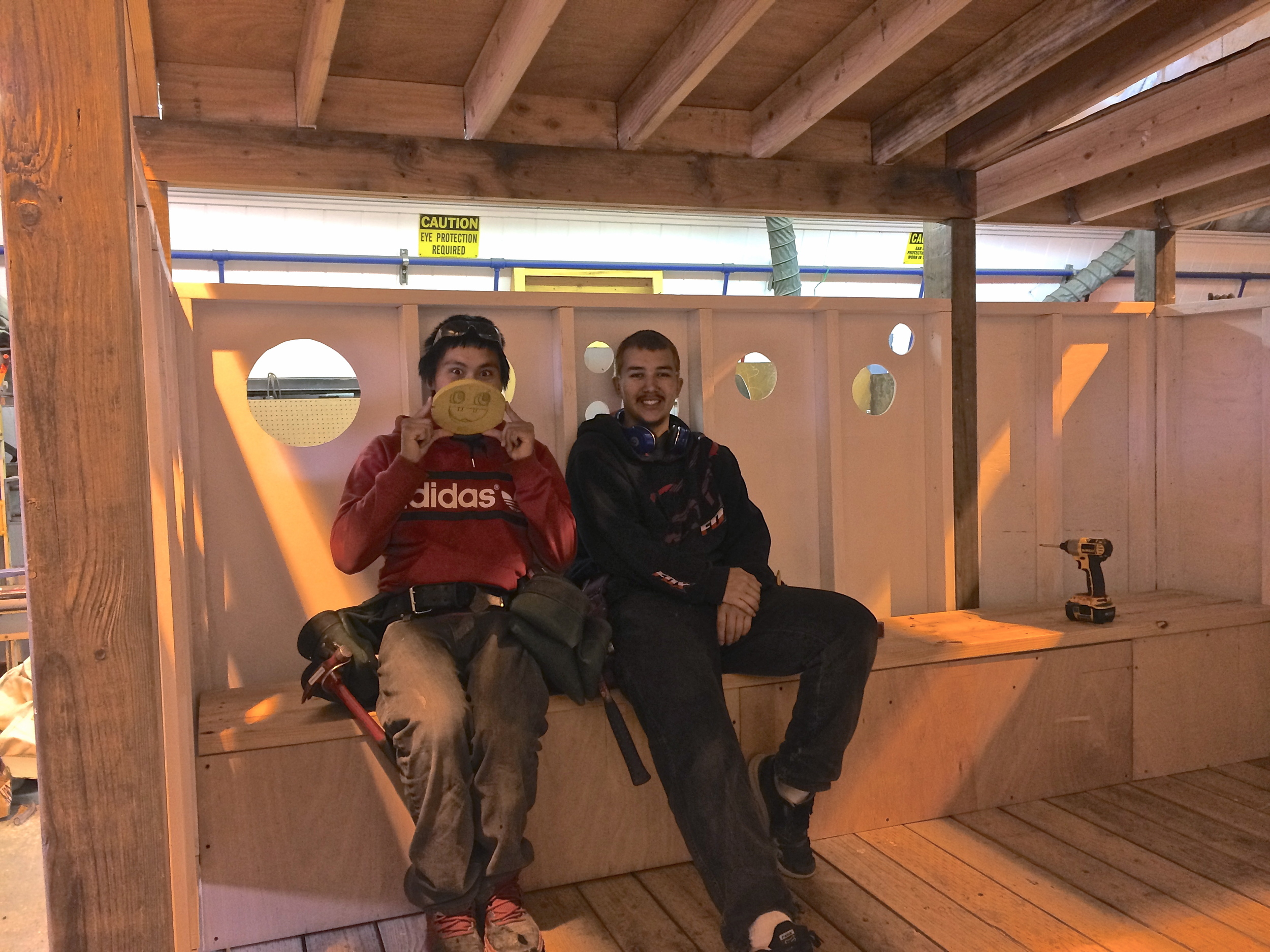 Dennis and Branham take a break on the bench they built.