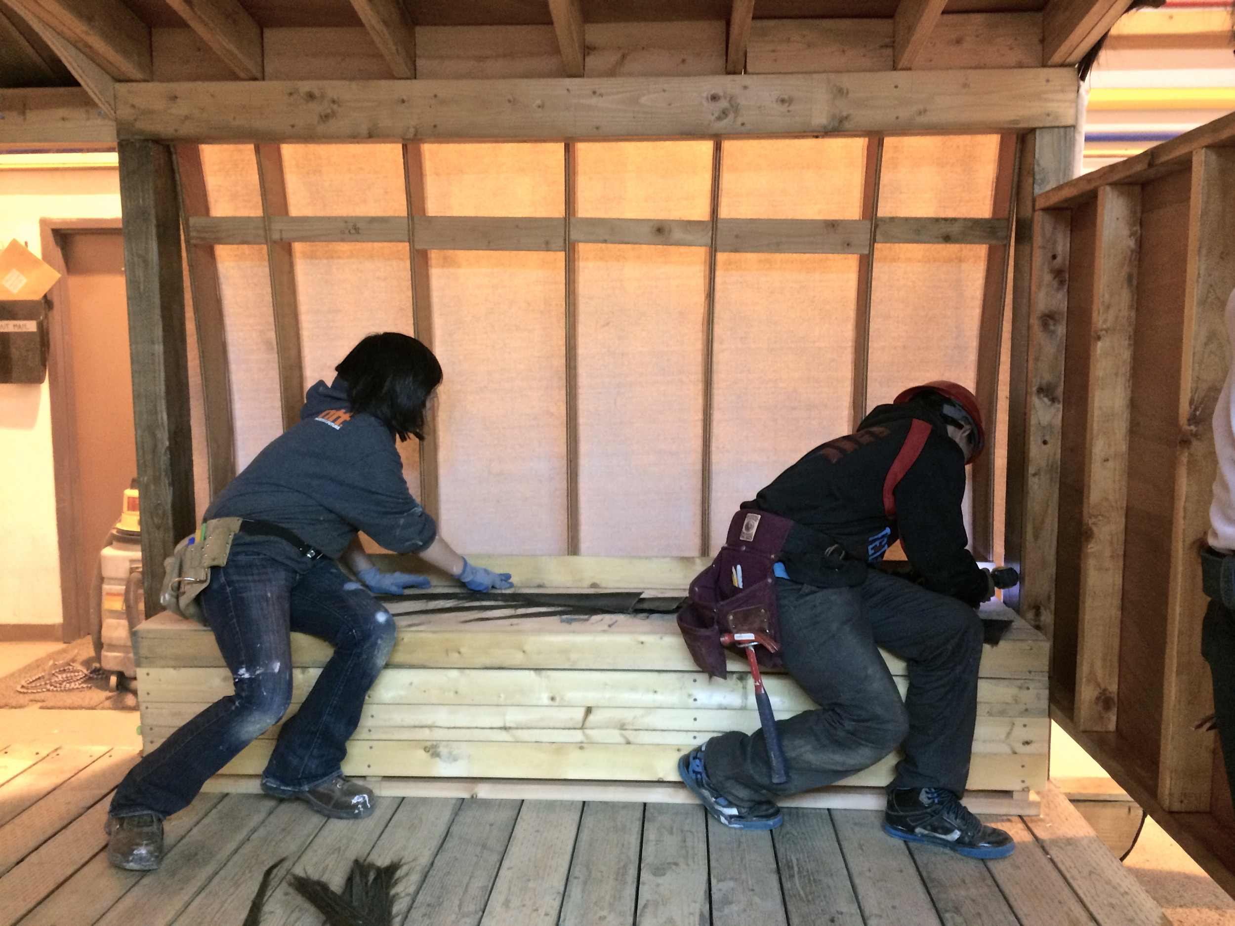Kirsten and Joe work on finishing a bench.