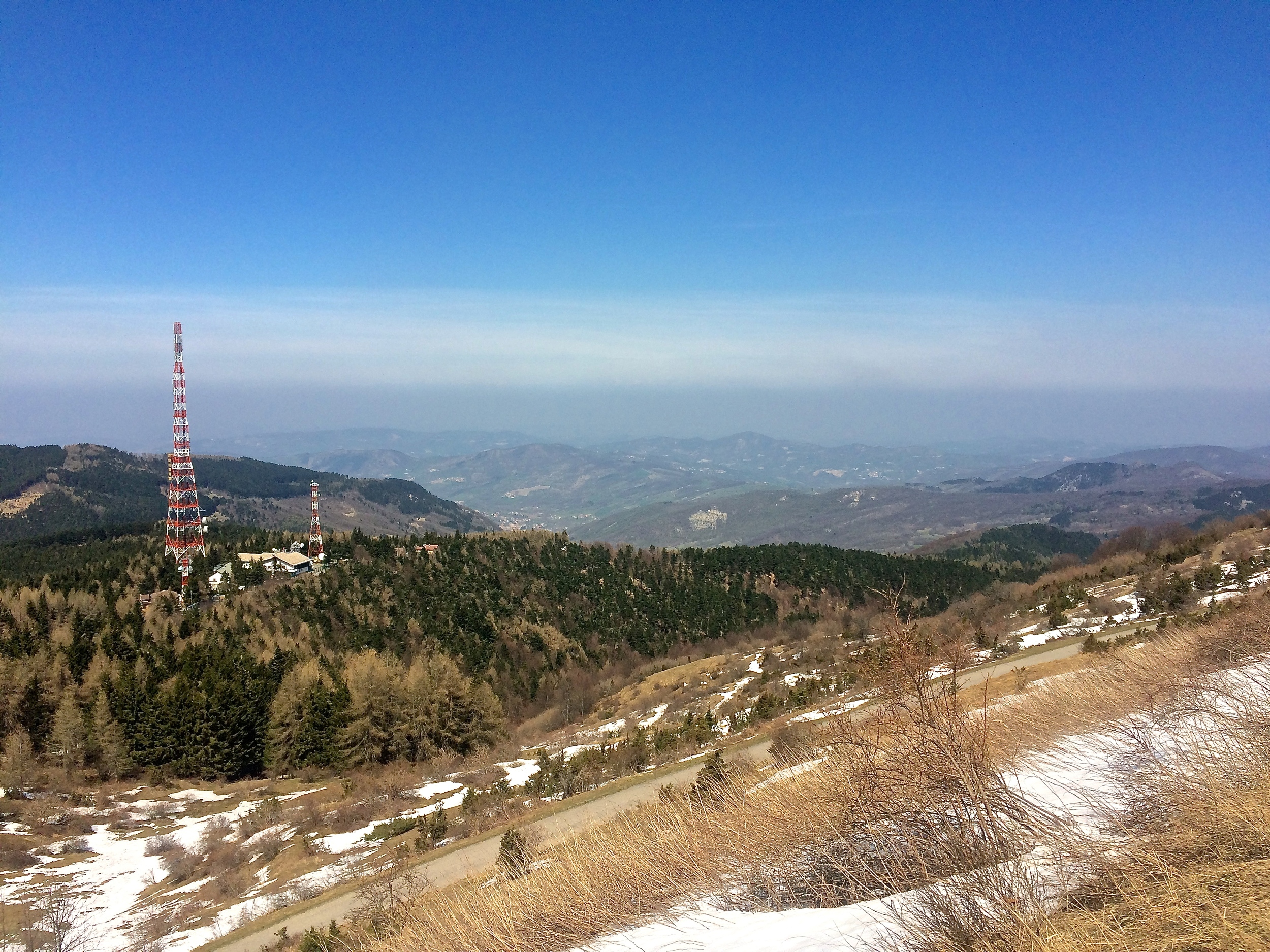The view from Monte Penice, one of the highest points in the Ligurian Apennines, is a beautiful panorama, but elevation of the peak makes it a prime point for cell towers, of which it hosts at least ten.
