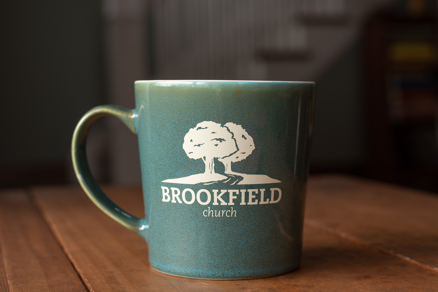 A coffee mug with an alternative logo for Brookfield Church in Athens, Ohio.