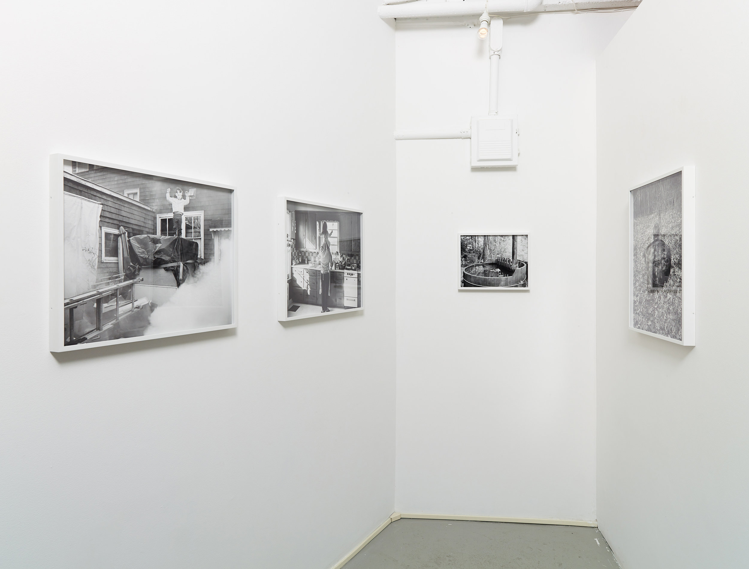 Installation view of black and white photographs by Scott Alario in his solo exhibition ' What We Conjure'