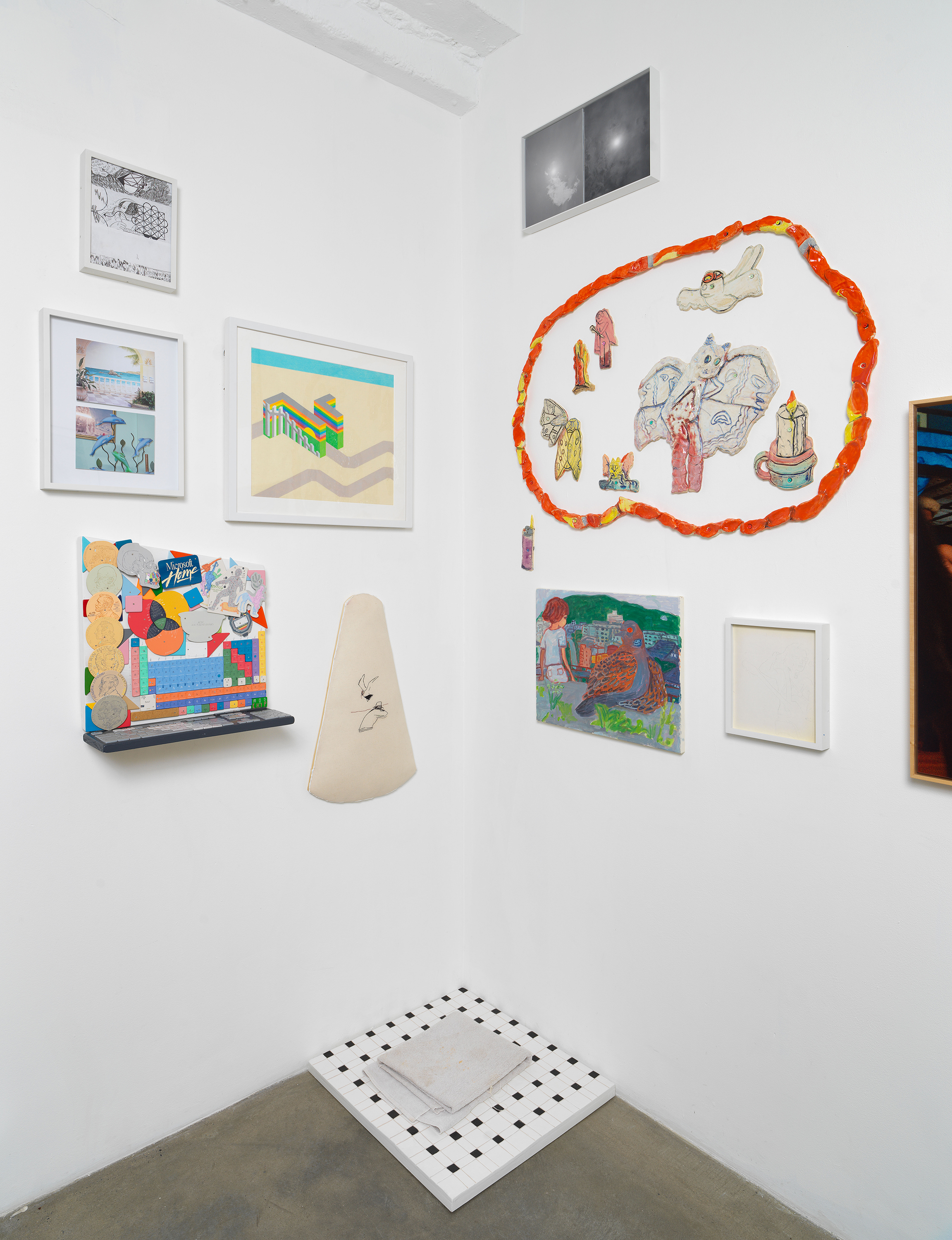 Installation view of 'Can You Dream It' featuring salon-style hanging of multimedia works by various artists and floor sculpture