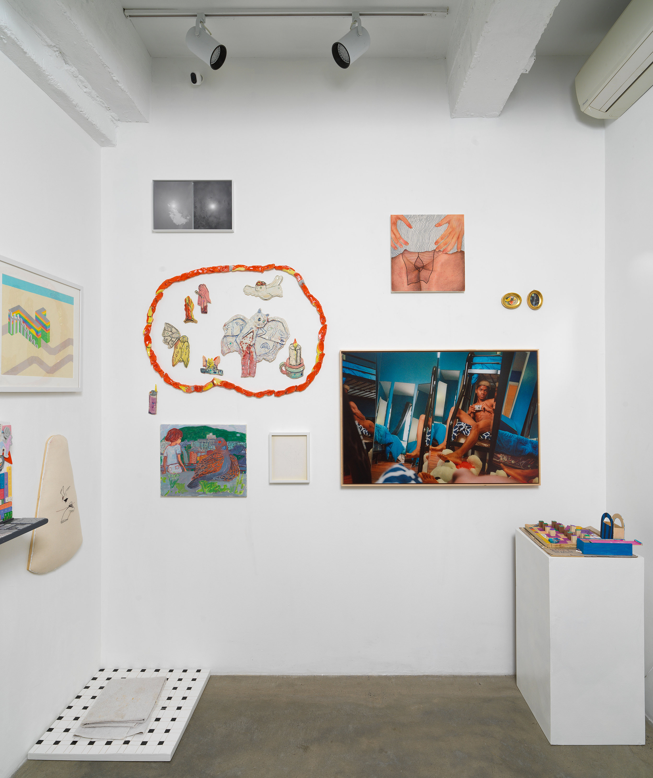 Installation view of 'Can You Dream It' featuring salon-style hanging of multimedia works by various artists, floor and pedesal-based sculpture