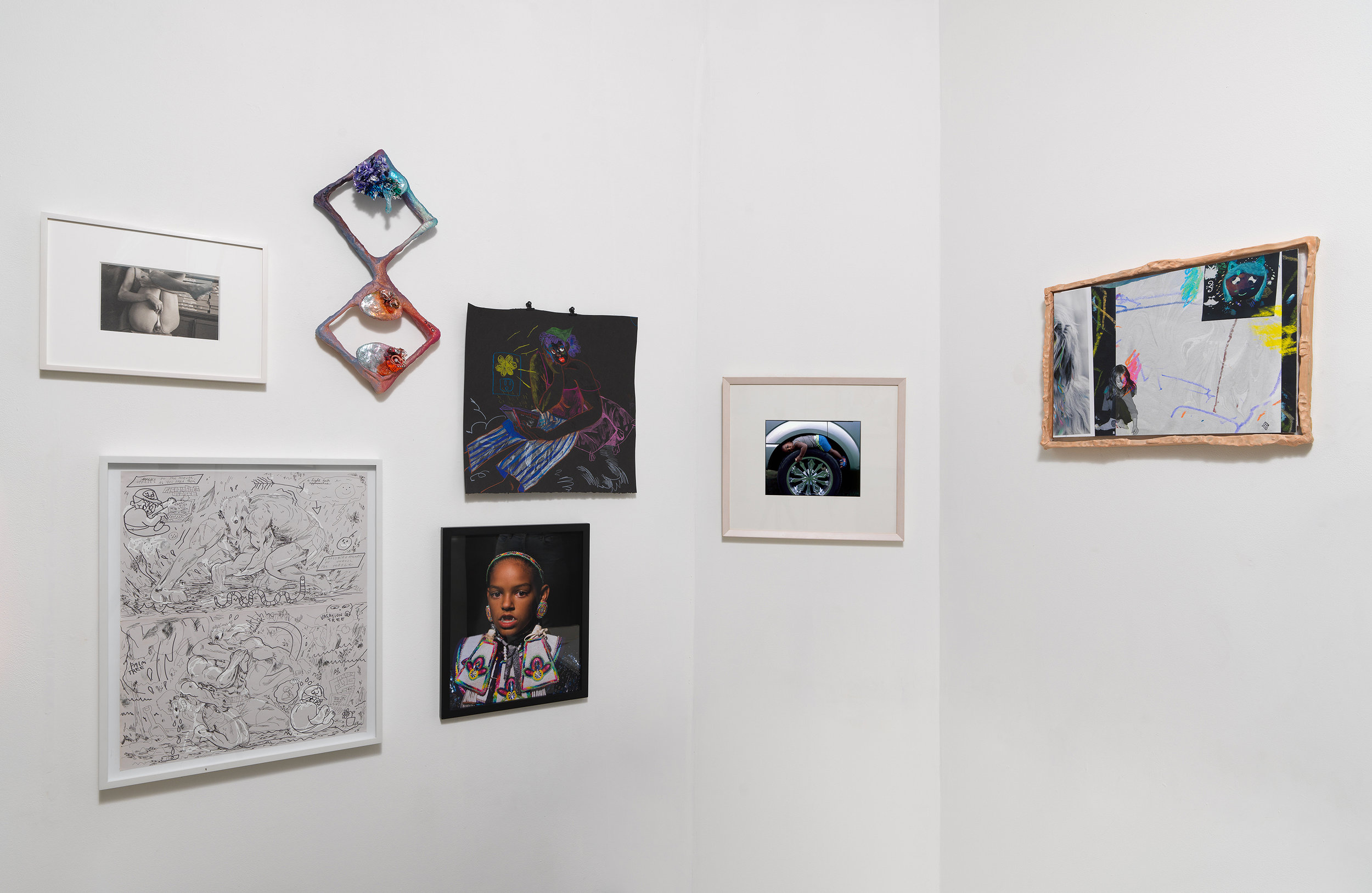 Installation view of 'Can You Dream It' featuring salon-style hanging of multimedia works by various artists