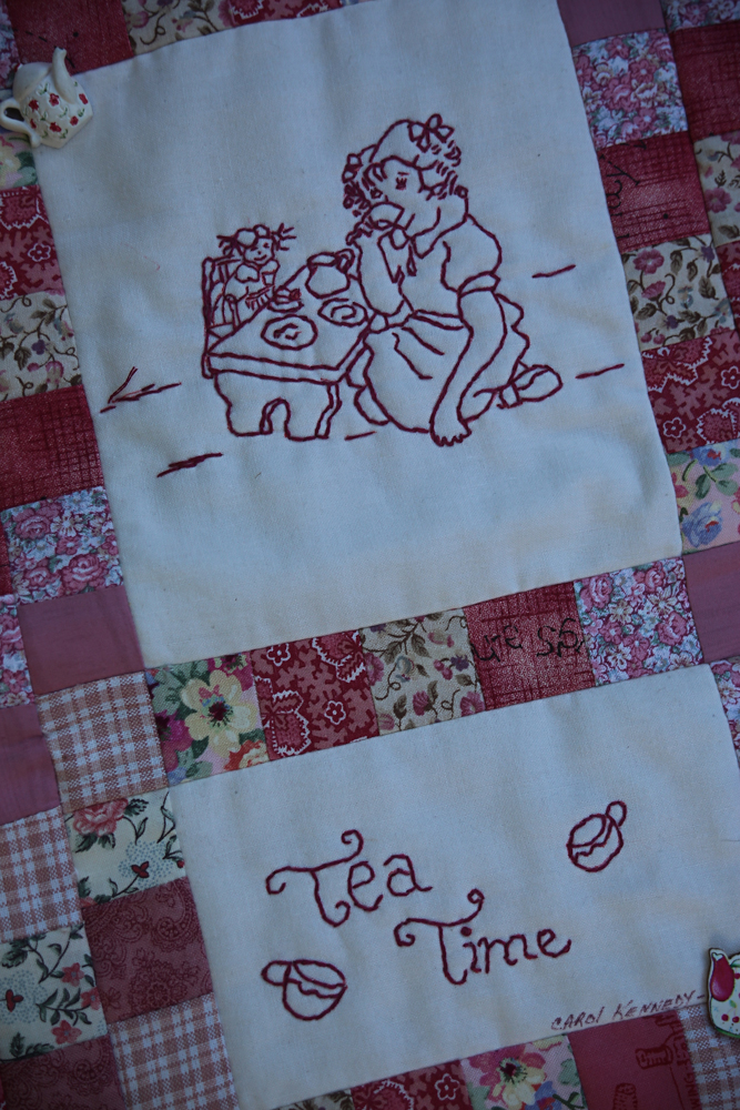 I found this sweet patchwork piece while I was out searching for tea party treasures.  It was perfect for what's to come from Scarlet Elfcup.  This piece was made by Carol Kennedy, a local crafter.  Unfortunately, she does not have a website, but you can find a lot of her work at our local craft market, the  Cranberry Hill Mercantile , in Sunnyvale.