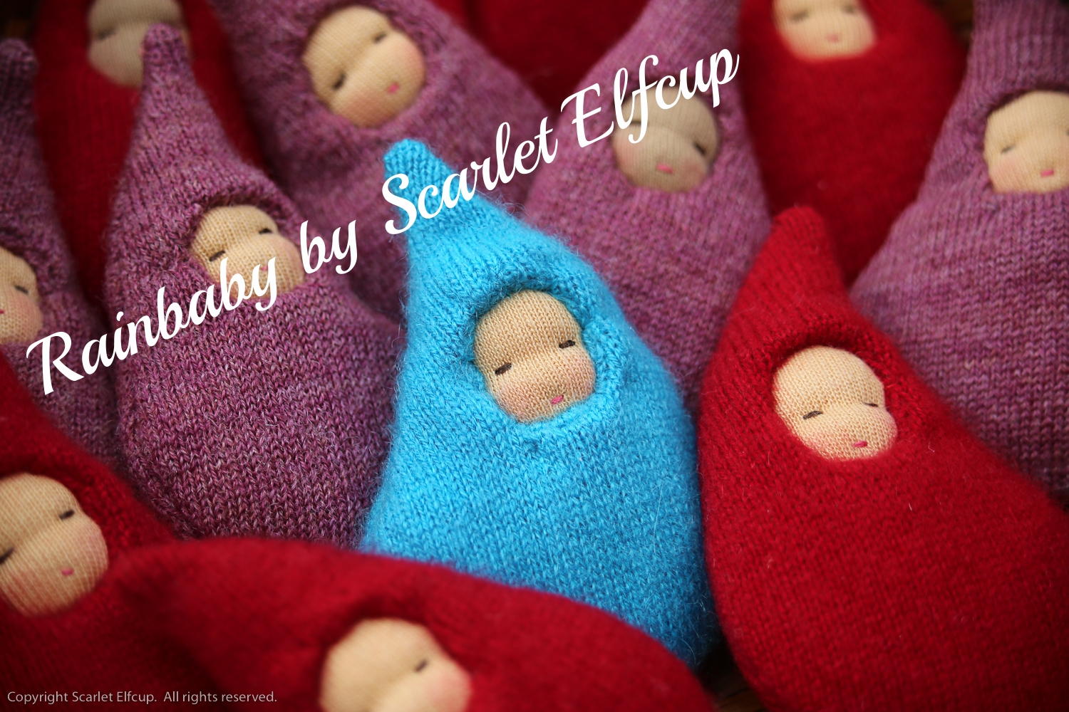 The Rainbaby was Scarlet Elfcup's very first creation. Read more about the inspiration behind this Scarlet Elfcup mascot  here .
