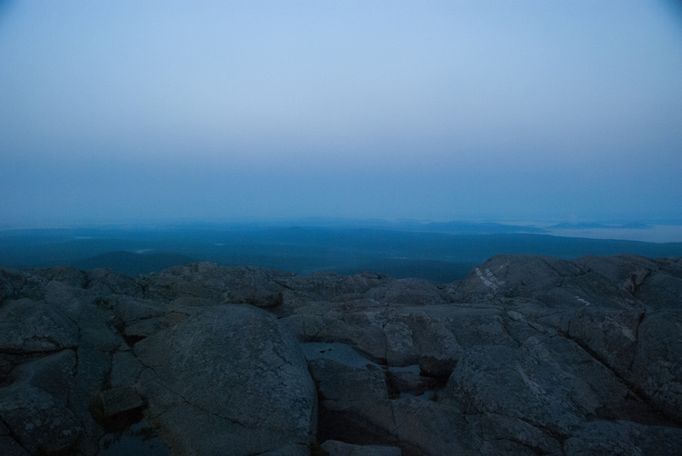 MORNING SKIES   Photo taken with a friend's borrowed Nikon with a Polarized lens. Started hiking Mount Monadnock around 3 am to make sure I was at the top to see the sunrise. This photo was taken only moments before the previous.