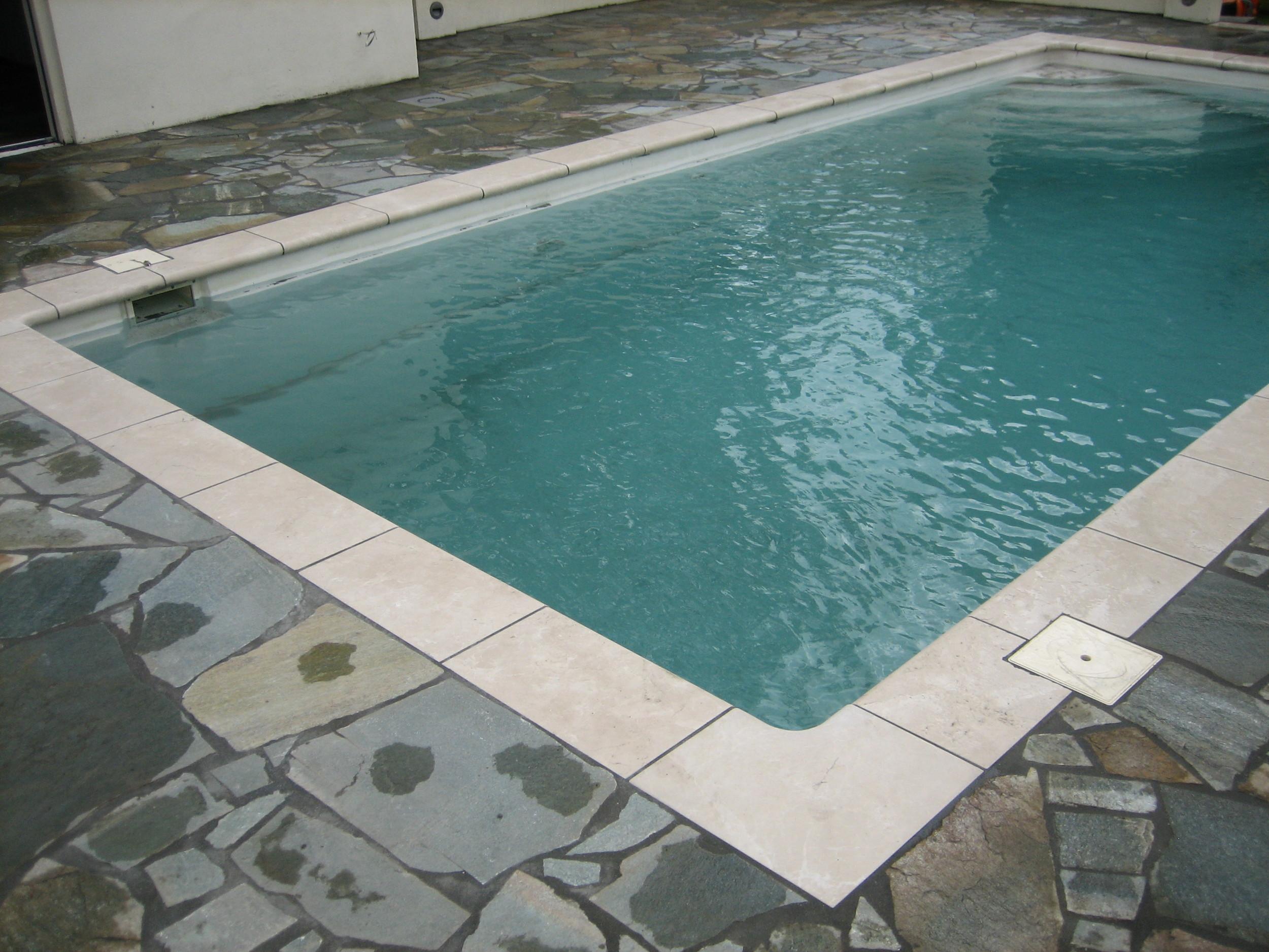 Zwembadranden en Flagstones zetten